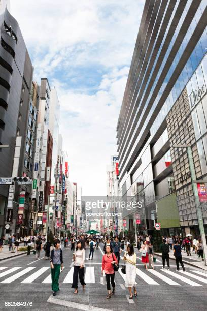 chuo dori street in the ginza district of tokyo, japan - chuo dori street stock photos and pictures