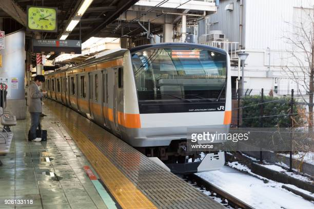 jr chuo line (rapid) train in tokyo, japan - suginami stock photos and pictures