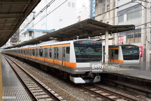 jr chuo line (rapid) trains in tokyo, japan - suginami stock photos and pictures