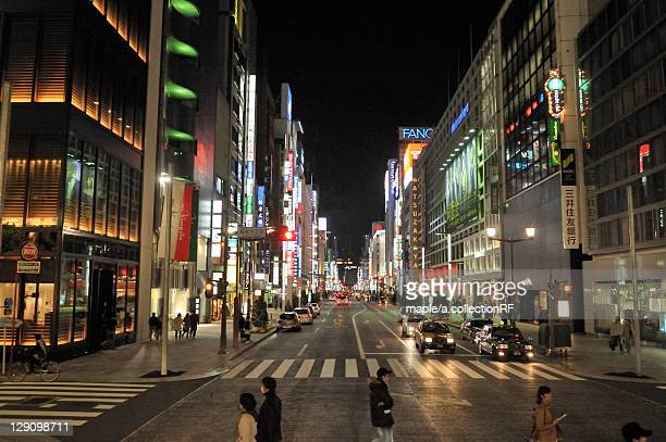 chuo street and ginza 6-chome at night - chuo dori street stock photos and pictures