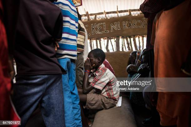 Chuol from southern Unity State, attends a Catholic mass on a Sunday alongside other internally displaced in Unity State, South Sudan, September 11,...