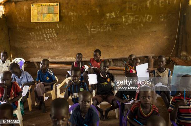 Chuol from southern Unity State, attends class with other internally displaced children and local villagers in a UNICEF-sponsored Child Friendly...