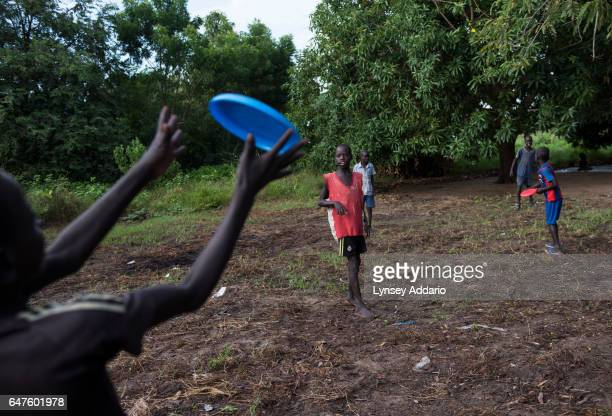 Chuol from southern Unity State, plays frisbee with other children in a UNICEF-sponsored Child Friendly Space in Unity State, South Sudan, September...