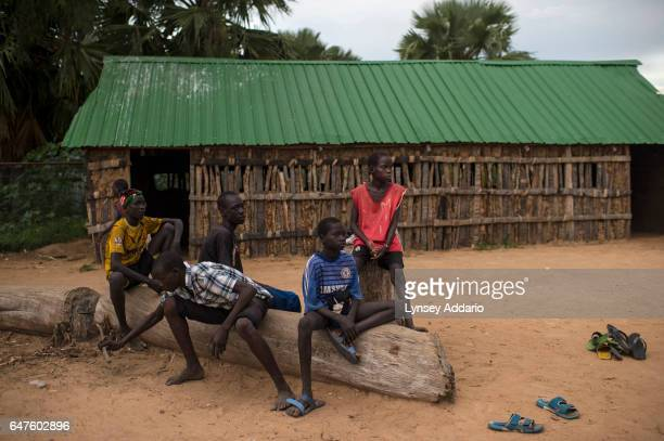 Chuol from southern Unity State, plays soccer with other local and internally displaced children at a school in a village in Unity State, South...