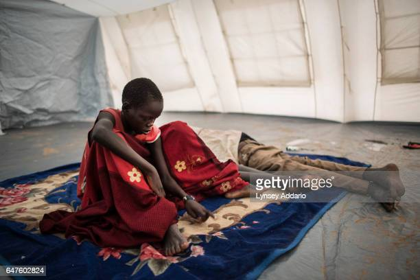 Chuol from southern Unity State, wakes up in a UNICEF tent school with other internally displaced children in Unity State, South Sudan, September 11,...