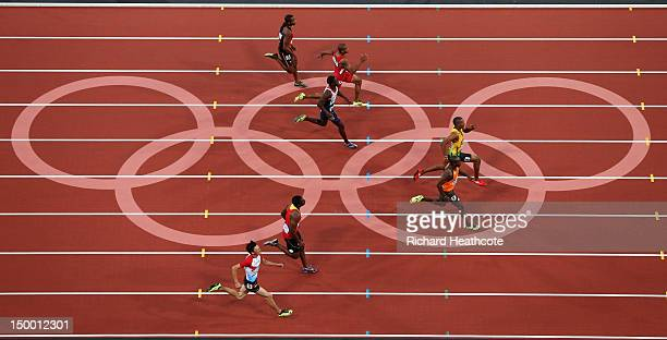 Churandy Martina of Netherlands crosses the finish line ahead of Warren Weir of Jamaica in the Men's 200m Semifinals on Day 12 of the London 2012...