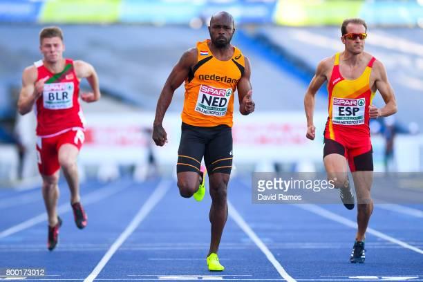 Churandy Martina of Netherlands wins past Dzlanis Konanau of Belarus and Angel David Rodriguez of Spain the Men's 100m heat 1 during day 1 of the...