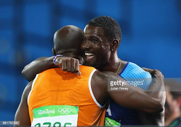 Churandy Martina of the Netherlands and Justin Gatlin of the United States embrace after the Men's 200m Semifinals on Day 12 of the Rio 2016 Olympic...