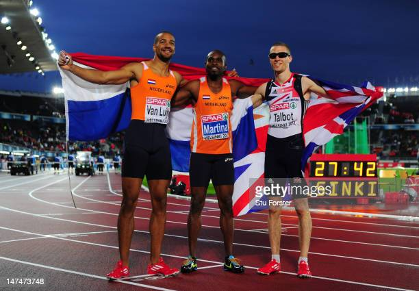 Churandy Martina of the Netherlands celebrates winning gold Patrick van Luijk the Silver and Daniel Talbot of Great Britain the bronze in the Men's...