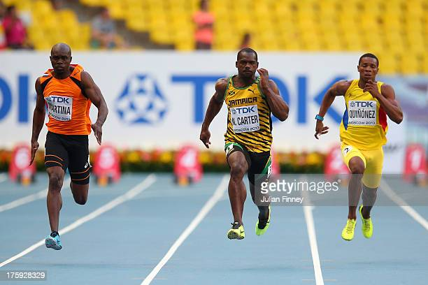 Churandy Martina of the Netherlands Nesta Carter of Jamaica and Alex Quinonez of Ecuador compete in the Men's 100 metres heats during Day One of the...