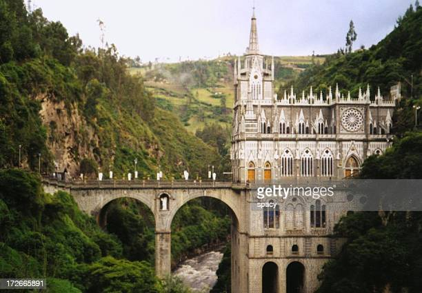 church accross a river with forest around - nariño department stock photos and pictures