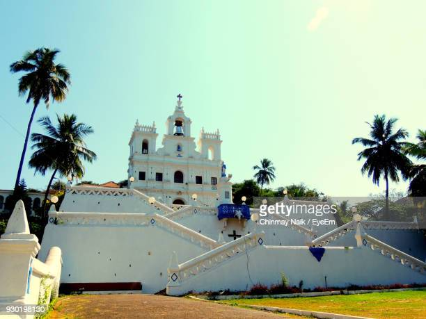 church against sky on sunny day - panjim stock photos and pictures