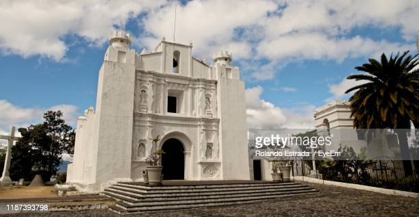 church against sky - guatemala city stock pictures, royalty-free photos & images