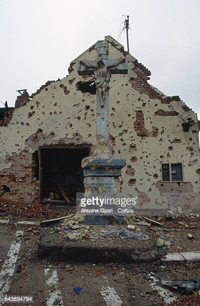 A church and a crucifix are riddled with bullet holes after a threemonth battle between the Croatian armed forces and the Yugoslavian Federal Army in...