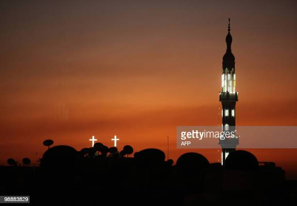 A church and a mosque are pictured at sunset in the southern Egyptian town of Nagaa Hammadi on January 9 two days after three gunmen sprayed...