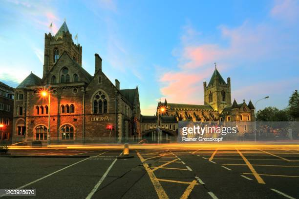 church and historic buildings at dusk with light trails of passing traffic - rainer grosskopf stock pictures, royalty-free photos & images