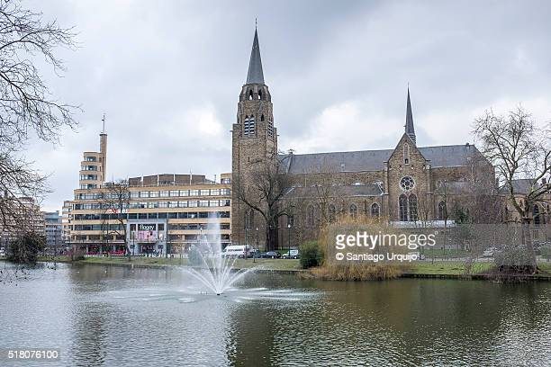 Church and old Radio Station by the pond in Ixelles