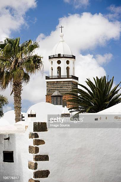 church and palm trees, teguise, lanzarote - lanzarote stock pictures, royalty-free photos & images