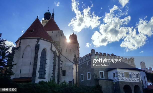 church and renaiassance style house in prachatice, czech republic - frans sellies stock pictures, royalty-free photos & images