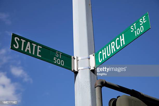 church and state road sign - identity politics stock pictures, royalty-free photos & images