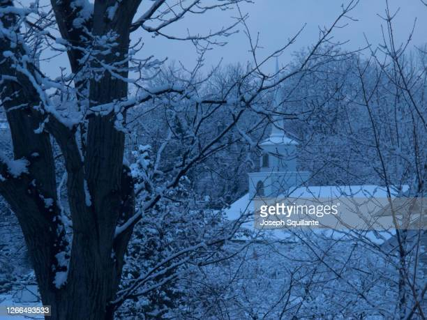 church and steeple in snow - joseph squillante stock pictures, royalty-free photos & images