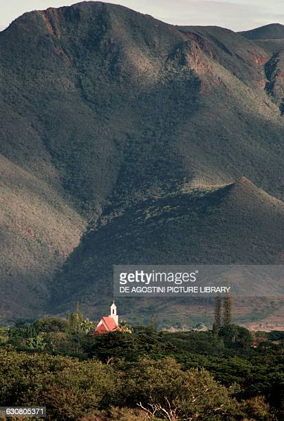 Church at the foot of a mountain Pouembout New Caledonia Overseas territory of the French Republic