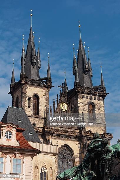 a church building with two towers and multiple spires and a statue in the foreground - terence waeland stock pictures, royalty-free photos & images