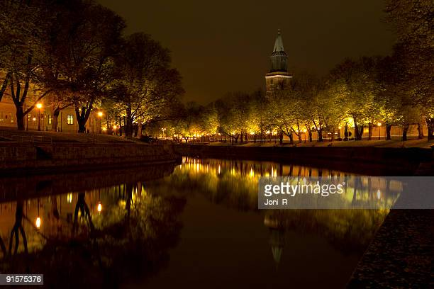 church by the river - turku finland stock photos and pictures