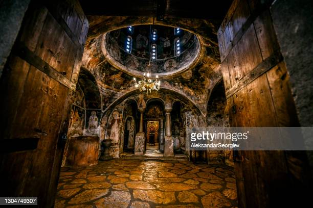 church candle lights and orthodox artwork inside st. naum monastery, ohrid, macedonia - empty tomb jesus stock pictures, royalty-free photos & images