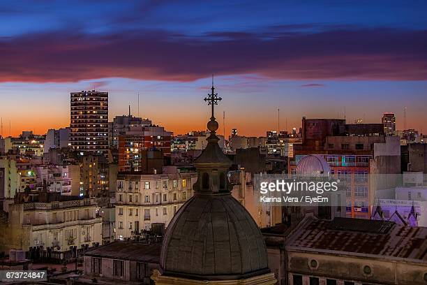 Church Dome Against Illuminated Cityscape During Sunset