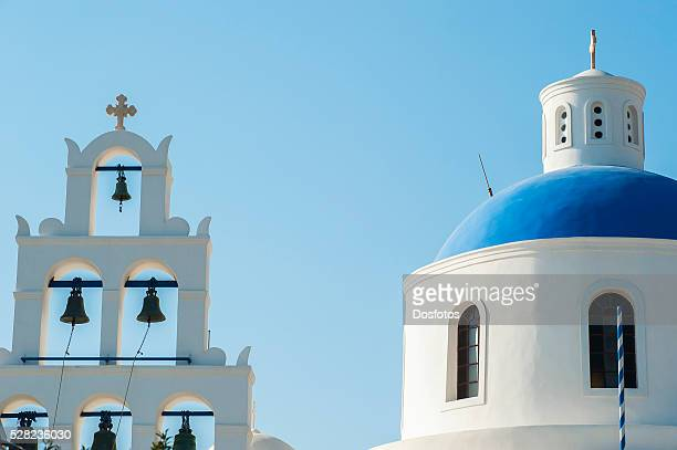 Church domed roof and bells; Oia, Santorini, Greece