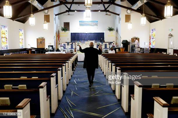 Church goers attend a walk thru Palm Sunday Service at Friendship Baptist Church held due to the COVID-19 pandemic on April 05, 2020 in Baltimore,...