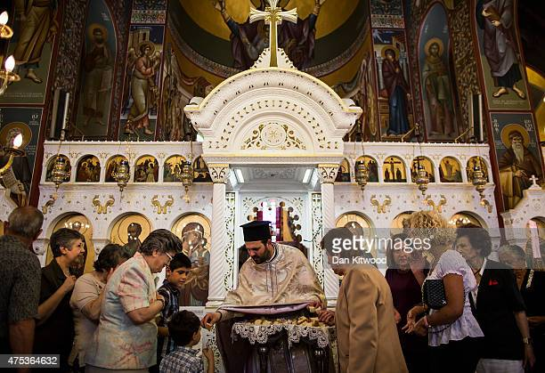 Church goers celebrate Pentecost at The Church of St Paul on May 31 2015 in Kos Greece Pentecost marks the descent of the Holy Spirit on the Apostles...