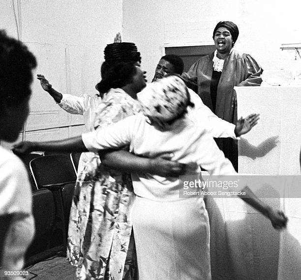 Church goers dance and sing while participating in a religious service at the Temple Apostolic Church a storefront church in Chicago IL 1967