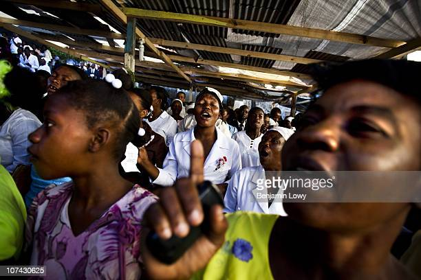 Church goers pray for victims of the Haitian earthquake during Sunday worship service at a church in Jacmel, Haiti on February 7 2010. Haiti was...