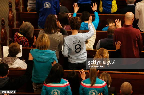 Church goers raise their hands in prayer during a special The Blessing of the Athletes service at the Old South Church on April 15 the five year...