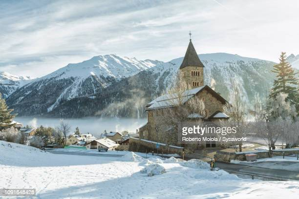 church herz-jesu-kirche, samedan, engadin, switzerland - kirche stock pictures, royalty-free photos & images
