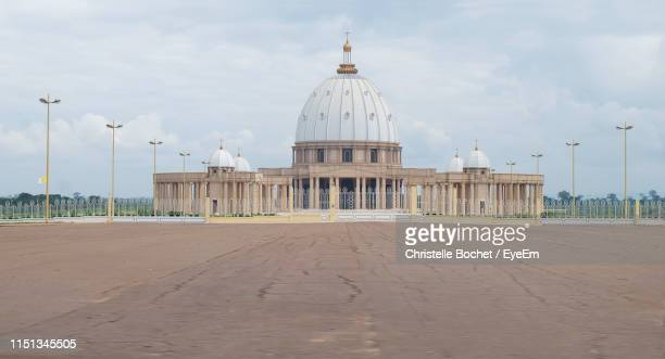church in city against sky - côte d'ivoire stock pictures, royalty-free photos & images