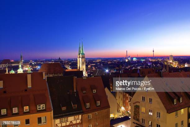 church in illuminated city against sky - nuremberg stock photos and pictures