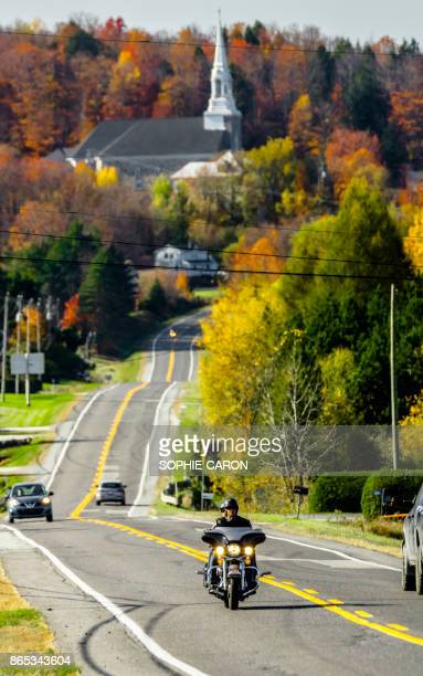 church in the eastern townships, autumn, motorcyclist. - eastern townships stock pictures, royalty-free photos & images