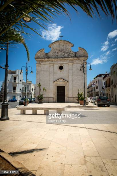 church in town plaza - polignano a mare stock photos and pictures