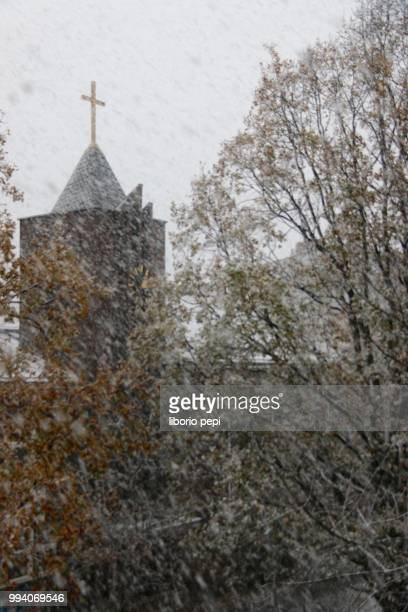 church in winter - liborio pepi stock-fotos und bilder