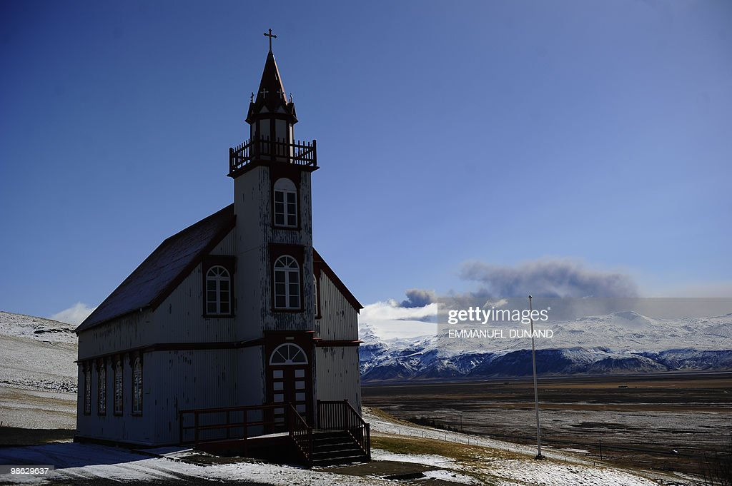 A church is pictured as smoke and ash billows from the Eyjafjallajokull volcano seen from Porolfsell on April 21, 2010. Europe's airspace reopened for business as Iceland's volcano lost its fury Wednesday, leaving passengers scrambling to get home and recriminations flying over the 1.7 billion dollar cost of the crisis. AFP PHOTO/Emmanuel Dunand