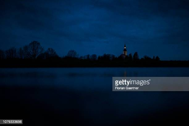 A church is pictured during blue hour on December 23 2018 in Diehsa Germany
