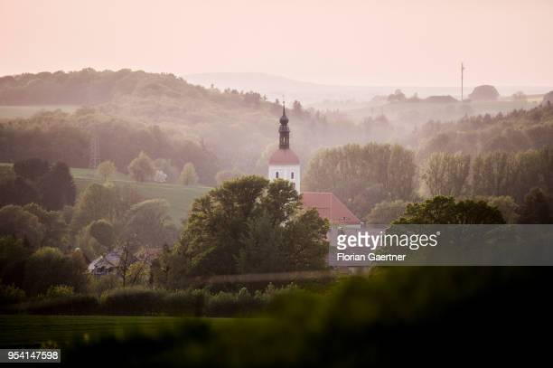 A church is pictured in the evening light on April 29 2018 in Kunnersdorf Germany
