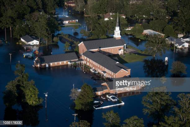 A church is surrounded by floodwaters from Hurricane Florence on September 17 in Conway South Carolina Many rivers in the Carolinas are approaching...