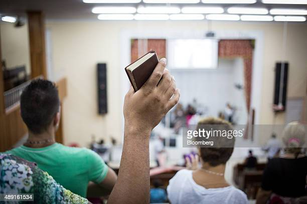A church member holds a Bible during service at the Evangelical Pentecostal Assembly of God Church in Havana Cuba on Friday Sept 18 2015 Cuba which...