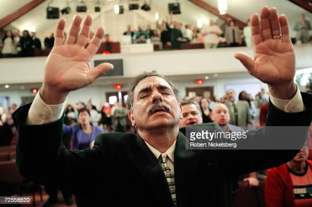 Church Member Joe Martinez of The Bay Ridge Christian Center Pentecostal Church prays during a twohour English language church service on April 10...