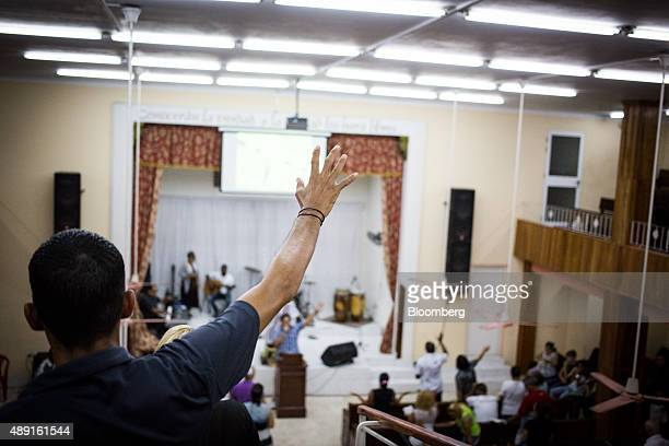 A church member raises his arm during service at the Evangelical Pentecostal Assembly of God Church in Havana Cuba on Friday Sept 18 2015 Cuba which...