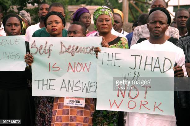 Church members carry placards reading self defence is now the answer the jihad will not work as they take part in a protest against the killing of...